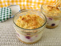 Cake in jar with berries and yogurt Stock Images