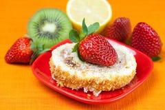 Cake,kiwi,lemon and strawberries Stock Photos