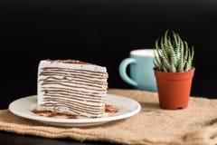 Cake layer chocolate. On white dish on black background Royalty Free Stock Images