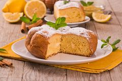 Cake with lemon cream filling. Cake with lemon cream filling on white dish stock image