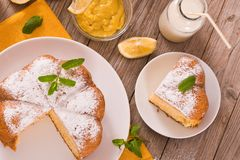 Cake with lemon cream filling. Cake with lemon cream filling on white dish royalty free stock image