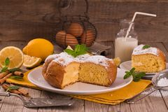Cake with lemon cream filling. Cake with lemon cream filling on white dish royalty free stock photography