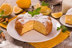 Cake with lemon cream filling. Cake with lemon cream filling on white dish royalty free stock images