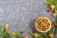 Cake with lemon jam and caramelized walnuts. Nut cake with lemon jam and caramelized walnuts. Decorated Christmas tree branches. Delicious Christmas dessert. Top Royalty Free Stock Photography