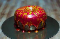Cake like big donut with fondant. Cake like big donut with red fondant stock photos