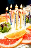 Cake with lit candles Stock Images