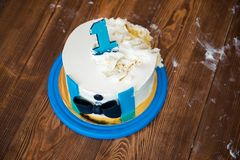 Cake for a little boy a gentleman. One year old boy child. Photo session crush smash cake. Baby`s first sweet dessert