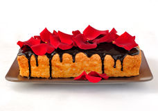 Cake loaf with rose petals Stock Images
