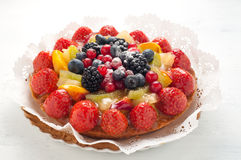 Cake with lots of fresh fruit : strawberries , kiwi , melon , be Royalty Free Stock Image