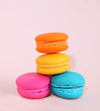 Cake macaron or macaroon on pink background from above, colorful Royalty Free Stock Photo
