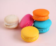 Cake macaron or macaroon on pink background from above, colorful Stock Photography