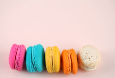 Cake macaron or macaroon on pink background from above, colorful Royalty Free Stock Image