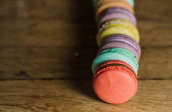Cake macaron or macaroon on turquoise background from above, col royalty free stock photos