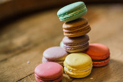 Cake macaron or macaroon on turquoise background from above, col Stock Photography
