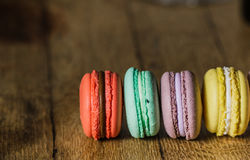 Cake macaron or macaroon on turquoise background from above, col royalty free stock image