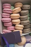Cake of macaroons or macaroons in a box stacked in rows, colorful almond cookies, pastel colors, vintage postcard Stock Image