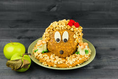 Cake made in the form of a hedgehog with mushrooms Stock Photo