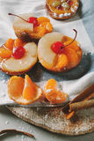Cake with mandarin on wooden desk, top view Royalty Free Stock Photos