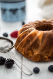 Cake. Marble cake cup of coffee powder sugar kitchen vintage utensil and fresh fruit berries Stock Images