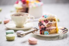 Cake from marzipan flowers macaroons and black coffee. royalty free stock image