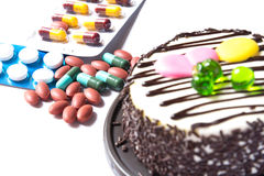 Cake and medicine Royalty Free Stock Images
