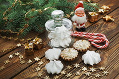 Cake and meringue. Cake and Christmas decorations on the table Stock Photo