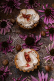 Cake with meringue and pumpkin apple jam on the background color. Old rustic table. Close-up stock image