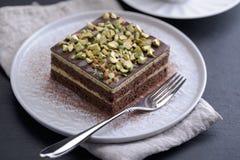 Cake met de close-up van Pistachenoten stock afbeelding