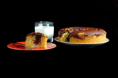 Cake and Milk. Slice of a delicious piece of marble cake served with a glass of milk Stock Images
