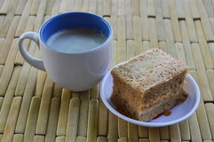 Cake and milk coffee on bamboo plate Stock Photo