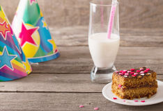 Cake and milk on wooden background Royalty Free Stock Images