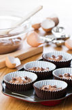 Cake Mixture. Chocolate chip cake mixture in cake cases ready for the oven Stock Images