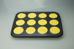 Cake mold filled with batter Royalty Free Stock Photography