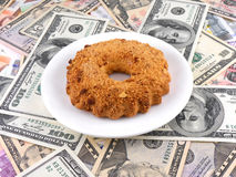 Cake on money dollars background Royalty Free Stock Photography