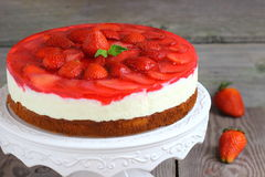 Cake mousse strawberry. On a plate royalty free stock photos