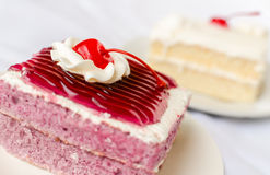 Cake with mousse whipping cream and cherry on top Royalty Free Stock Images