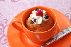 Cake in a mug. A cake in a mug with cream stock images