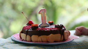 Cake for my birthday for a year with cherries with candle stock video footage