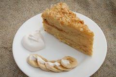 Cake Napoleon. Banana, cream on the background of burlap Stock Image