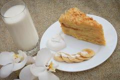 Cake Napoleon. Banana, cream on the background of burlap Stock Photography