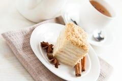 Cake Napoleon close-up with tea Royalty Free Stock Photo