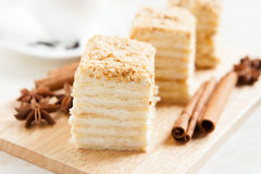 Cake Napoleon with sour cream on plate Royalty Free Stock Images