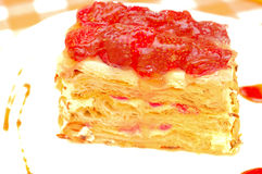 Cake Napoleon with strawberry on the plate Stock Photography