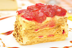 Cake Napoleon with strawberry on the plate Stock Images