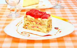 Cake Napoleon with strawberry on the plate Royalty Free Stock Image