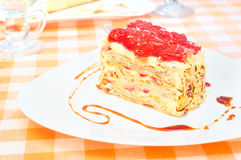 Cake Napoleon with strawberry on the plate Stock Photos