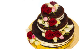 Cake with natural flowers. Isolated on white background Stock Photography
