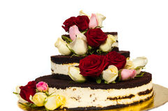 Cake with natural flowers. Isolated on white background Royalty Free Stock Photography