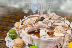 Cake for new year and christmas, candles number 2017 on backgrou Royalty Free Stock Image