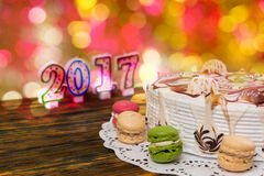 Cake for new year and christmas with macarons, candles number 20 Royalty Free Stock Photos